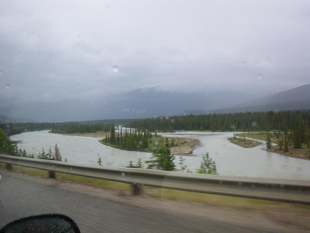 It is raining on the way to Fairmont Jasper Park Lodge.